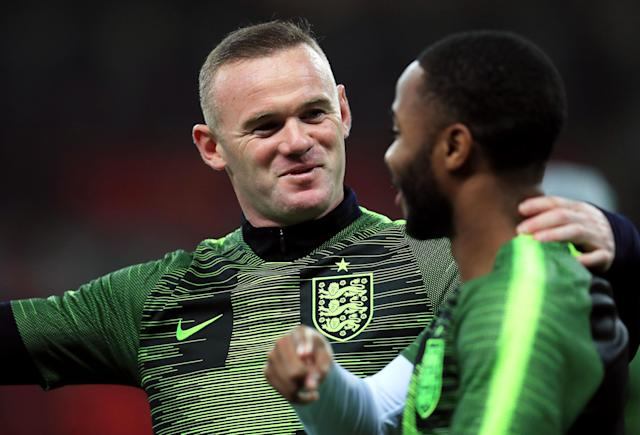Rooney and Raheem Sterling in conversation during the warm-up (Mike Egerton/PA)
