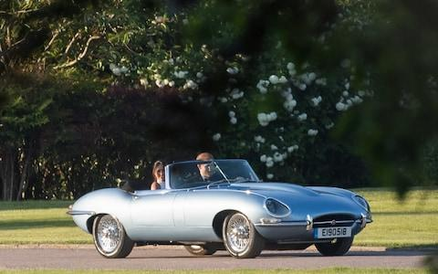 The Duke and Duchess made their way to the Frogmore House reception in a vintage Jaguar E-Type Concept Zero - Credit: Samir Hussein