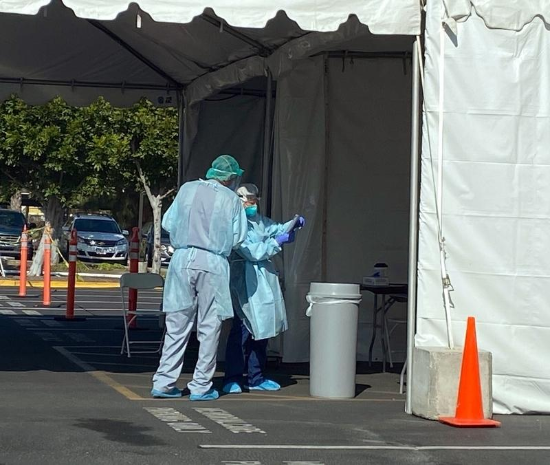 First responders are seen in hazmat suits at a local Orange County testing center during the coronavirus pandemic, April 01, 2020.