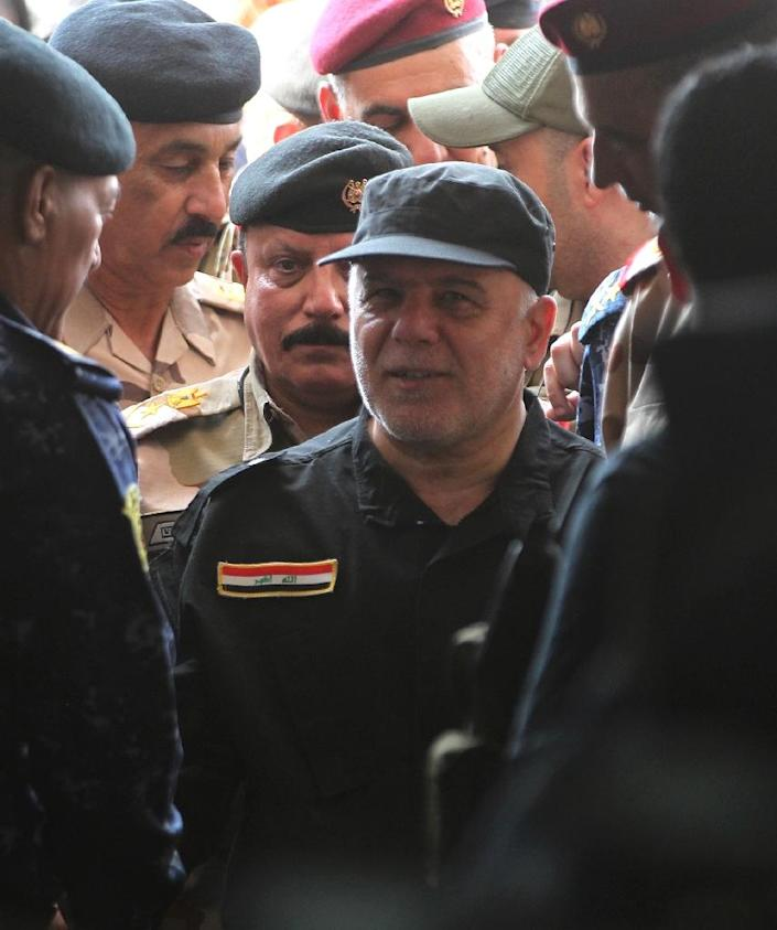 """Iraqi Prime Minister Haider al-Abadi arrives in the al-Tayaran neighborhood of Mosul on July 9, 2017 to meet with military commanders after the government's announcement of the """"liberation"""" of the embattled city (AFP Photo/AHMAD AL-RUBAYE)"""