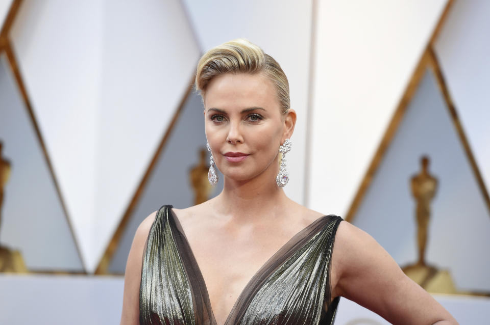 Charlize Theron arrives at the Oscars on Sunday, Feb. 26, 2017, at the Dolby Theatre in Los Angeles. (Photo by Jordan Strauss/Invision/AP)