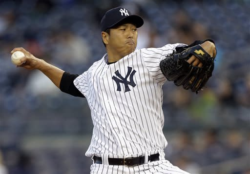 New York Yankees starting pitcher Hiroki Kuroda winds up against the Houston Astros in the first inning of a baseball game at Yankee Stadium in New York, Tuesday, April 30, 2013. (AP Photo/Kathy Willens)
