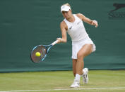 Poland's Magda Linette plays a return to Ukraine's Elina Svitolina during the women's singles second round match on day four of the Wimbledon Tennis Championships in London, Thursday July 1, 2021. (AP Photo/Kirsty Wigglesworth)