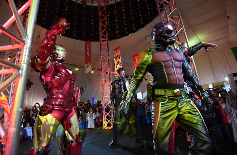 People dressed up as members of Marvel's Avengers perform on stage during Saudi Arabia's first ever Comic-Con event in the coastal city of Jeddah on February 16, 2017 (AFP Photo/FAYEZ NURELDINE)
