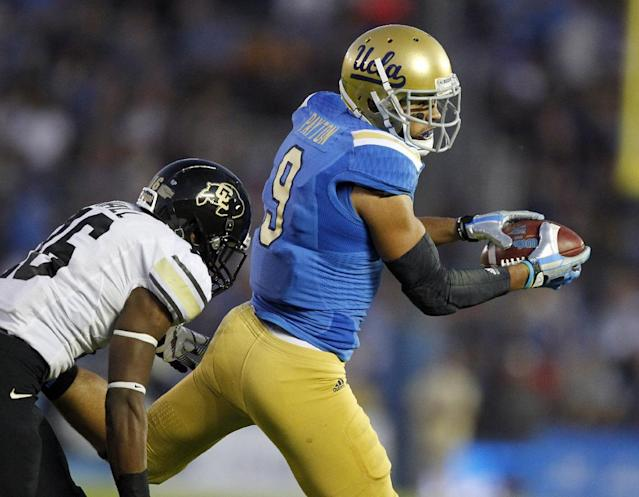 UCLA wide receiver Jordan Payton, right, catches a pass with Colorado defensive back Jeffrey Hall, left, defending in the first half of their NCAA college football game Saturday, Nov. 2, 2013, in Pasadena, Calif. (AP Photo/Alex Gallardo)