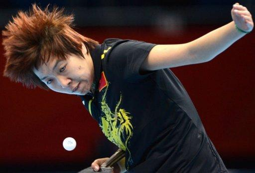 China's Li Xiaoxia returns the ball toward Japan's Ai Fukuhara
