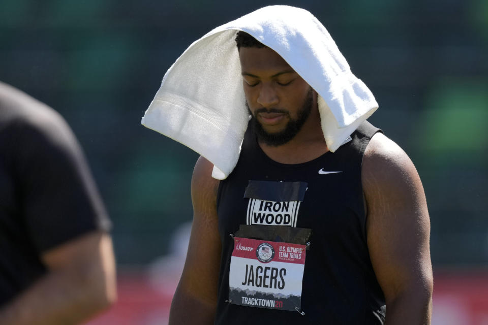Reggie Jagers tries to keep cool under a towel during the finals of men's discus throw at the U.S. Olympic Track and Field Trials Friday, June 25, 2021, in Eugene, Ore. (AP Photo/Charlie Riedel)