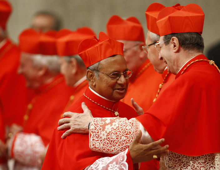 """FILE - This Nov. 20, 2010 file photo shows Archbishop of Colombo, Sri Lanka, Albert Malcolm Ranjith Patabendige Don being elevated to cardinal during a consistory inside St. Peter's Basilica, at the Vatican. Ranjith, who in 2010 was named Sri Lanka's second cardinal in history, now is being mentioned among the possible successors to Benedict XVI if the conclave looks beyond Europe to acknowledge the shifting """"southern'' demographics of the church. (AP Photo/Pier Paolo Cito, File)"""