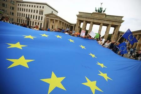 """Demonstrators hold an EU flag during a rally under the slogan """"Stop the Coup"""" to protest against attempts to force through a no-deal Brexit, in Berlin"""