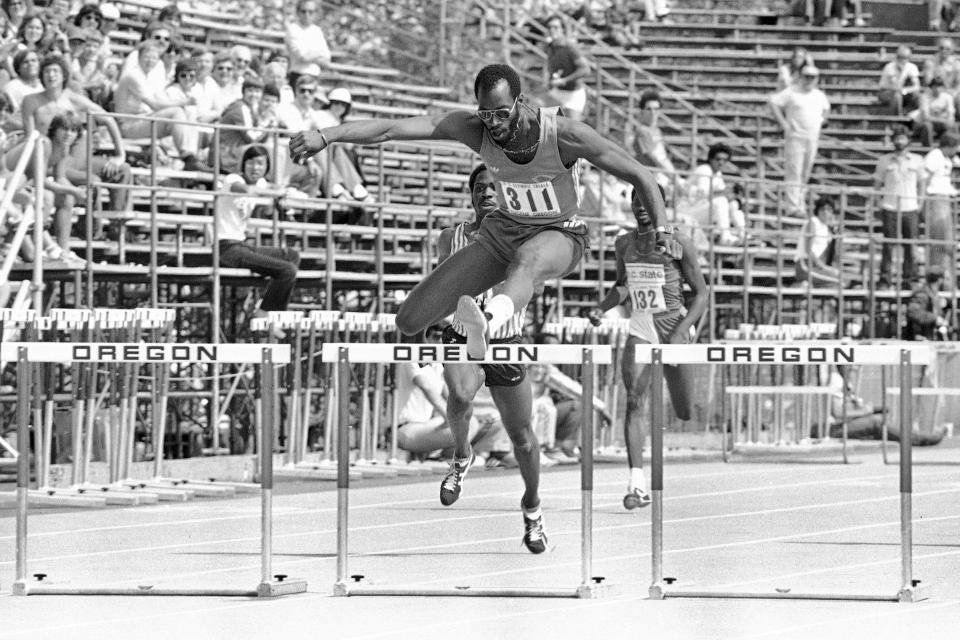 FILE - In this June 21, 1980, file photo, Edwin Moses, gold medal winner in 1976 in Montreal, wins in the 400 intermediate hurdles as the 1980 Olympic trials in Eugene, Ore. Moses, the man who once won a remarkable 107 finals in a row from 1977-87 and who lowered the world record to 47.02 seconds during his prime, says he has been enjoying watching hurdlers break new barriers over the past two years. (AP Photo/File)