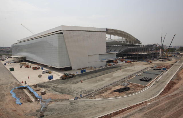 Construction continues at the Itaquerao stadium in Sao Paulo, Brazil, Wednesday, April 9, 2014. The stadium is slated to host the World Cup opener match between Brazil and Croatia on June 12. About 20,000 temporary seats are being installed behind the goals to increase the stadium's capacity to nearly 70,000. (AP Photo/Andre Penner)