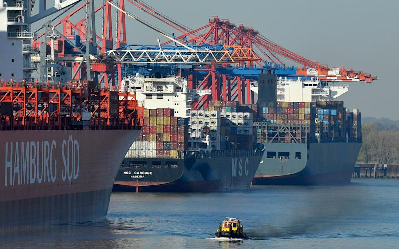 Container ships are loaded at the harbor in Hamburg, Germany, Monday, Oct. 15, 2018. The container port is one of Europe's biggest destination for import and export. (AP Photo/Martin Meissner)