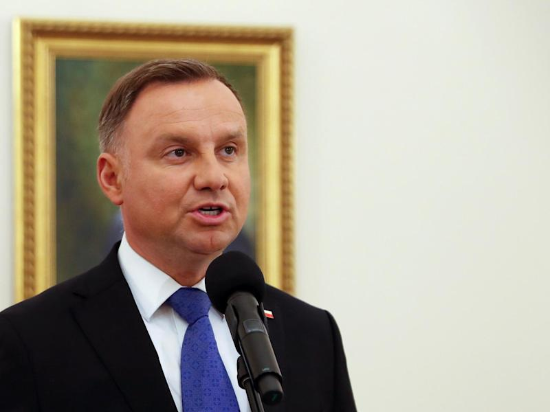The incumbent president Andrzej Duda talks to the media in Warsaw, Poland, after the first exit polls were announced on 12 July, 2020: Reuters