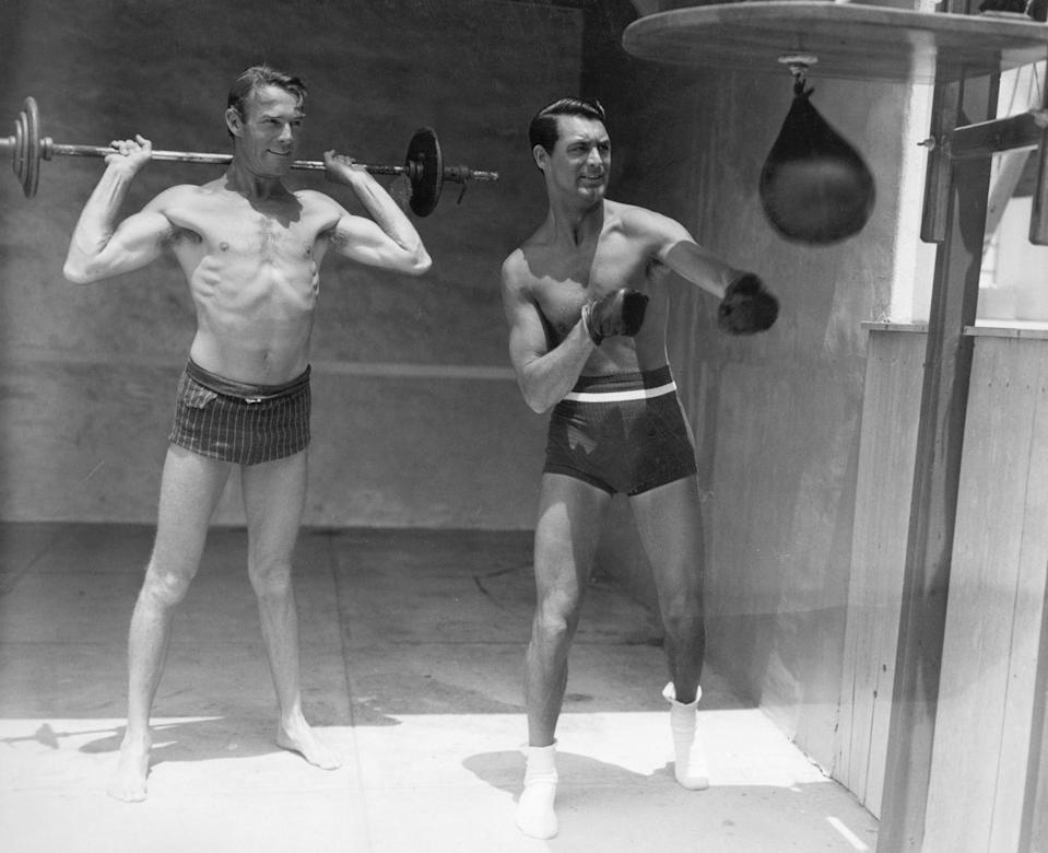 """<p>Grant moved in with his close friend, Randolph Scott, in 1932. After meeting on the Paramount lot while Grant was shooting <em>Sinners in the Sun</em>, the pair hit it off and ended up living together on and off for the next 12 years. There were rumors of the relationship being romantic, however <a href=""""https://www.universityfox.com/stories/cary-grants-daughter-and-former-wife-talk-about-his-struggles-with-family-life/"""" rel=""""nofollow noopener"""" target=""""_blank"""" data-ylk=""""slk:many have disputed those claims"""" class=""""link rapid-noclick-resp"""">many have disputed those claims</a>, including Grant's wives.</p>"""