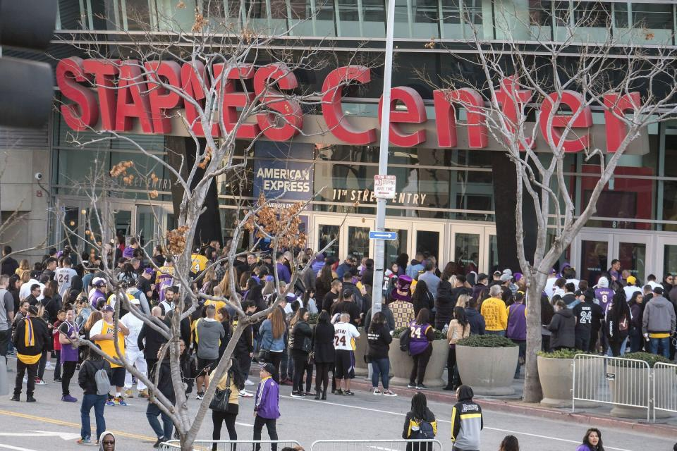 """Fans lined up early Monday to get into the Staples Center in L.A. to attend the public memorial for former Los Angeles Lakers star Kobe Bryant and his 13-year-old daughter, Gianna, who were <a href=""""https://people.com/sports/everything-to-know-about-kobe-bryant-helicopter-crash-details/"""" rel=""""nofollow noopener"""" target=""""_blank"""" data-ylk=""""slk:killed in a helicopter crash"""" class=""""link rapid-noclick-resp"""">killed in a helicopter crash</a> on Jan. 26 along with seven others."""