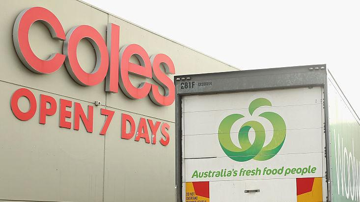 A Woolworths truck is parked outside a Coles Supermarket on May 25, 2015 in Melbourne, Australia.