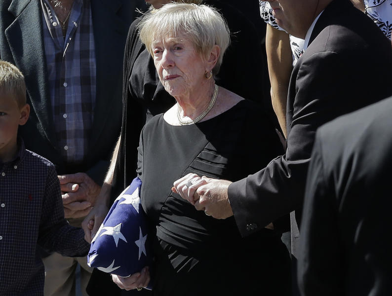 "This photo taken Sept. 19, 2012 shows Barbara Doherty, mother of slain former Navy SEAL Glen Doherty, escorted from the Church of St. Eulalia in Winchester, Mass., after his funeral. What do a Navy mom, Big Bird and AARP have in common? They all want President Barack Obama and Republican Mitt Romney to leave them alone. The two candidates are drawing on personal stories and pop culture references in campaign ads, daily speeches and debate zingers as each seeks to cast himself as an ""everyman"" and broaden his appeal in the presidential race's closing weeks. But they're encountering resistance at seemingly every turn by a broad collection of people they mention and entities they reference. And this year, the complaints go beyond those that usually occur during campaign years: griping by musical groups whose songs candidates use at rallies. (AP Photo/Elise Amendola)"