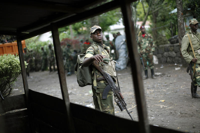 FILE - In this Dec. 1, 2012 file photo, M23 rebels withdraw from the eastern Congo town of Goma. Eleven African countries signed a United Nations-drafted peace deal on Sunday, Feb. 24, 2013, to stabilize the troubled Central African country of Congo, where rebels allegedly backed by neighboring countries last year threatened to oust the government. Congo's neighbors collectively promised not to interfere in the internal affairs of the Congo or to tolerate or support armed groups. A U.N. report last year said that Rwanda and Uganda helped aid M23 rebels inside Congo. The two countries denied the allegations. (AP Photo/Jerome Delay, File)
