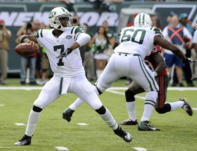 FILE - In this Sept. 8, 2013, file photo, New York Jets quarterback Geno Smith (7) throws a pass against the Tampa Bay Buccaneers during the first half of an NFL football game in East Rutherford, N.J. Smith was 10 years old when Tom Brady played his first game against the Jets. On Thursday night, New York's rookie quarterback makes his debut in the rivalry against the New England Patriots' 14-year veteran. (AP Photo/Bill Kostroun, File)