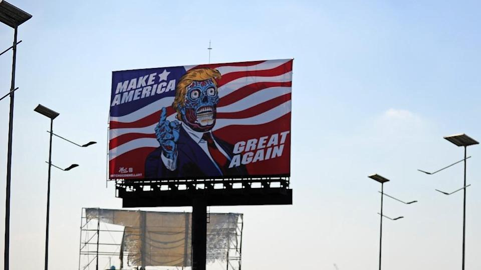 """A billboard by US artist Mitch O'Connell depicting President Donald Trump displayed in Mexico City is in allusion and tribute to John Carpenter's 1988 cult movie """"They Live"""" (AFP Photo/Bernardo Montoya)"""