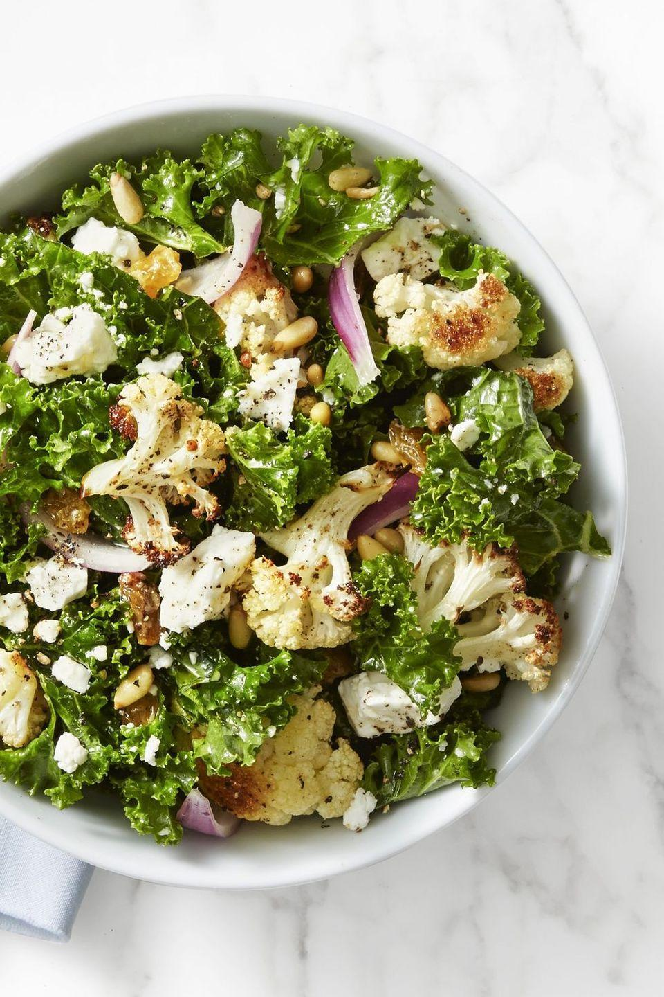 """<p>Packed with roasted cauliflower, feta cheese, golden raisins and pine nuts, this salad is a delicious way to get some nutrients onto your holiday table. Leave out the cheese if you're pairing this with a roast!</p><p><em><a href=""""https://www.goodhousekeeping.com/food-recipes/easy/a42424/kale-roasted-cauliflower-salad-recipe/"""" rel=""""nofollow noopener"""" target=""""_blank"""" data-ylk=""""slk:Get the recipe for Kale and Roasted Cauliflower Salad »"""" class=""""link rapid-noclick-resp"""">Get the recipe for Kale and Roasted Cauliflower Salad »</a></em></p><p><strong>RELATED: </strong><a href=""""https://www.goodhousekeeping.com/food-recipes/healthy/g31116887/spring-salads/"""" rel=""""nofollow noopener"""" target=""""_blank"""" data-ylk=""""slk:33 Fresh, Colorful Spring Salads That'll Make It Easy to Eat Your Veggies"""" class=""""link rapid-noclick-resp"""">33 Fresh, Colorful Spring Salads That'll Make It Easy to Eat Your Veggies</a><br></p>"""