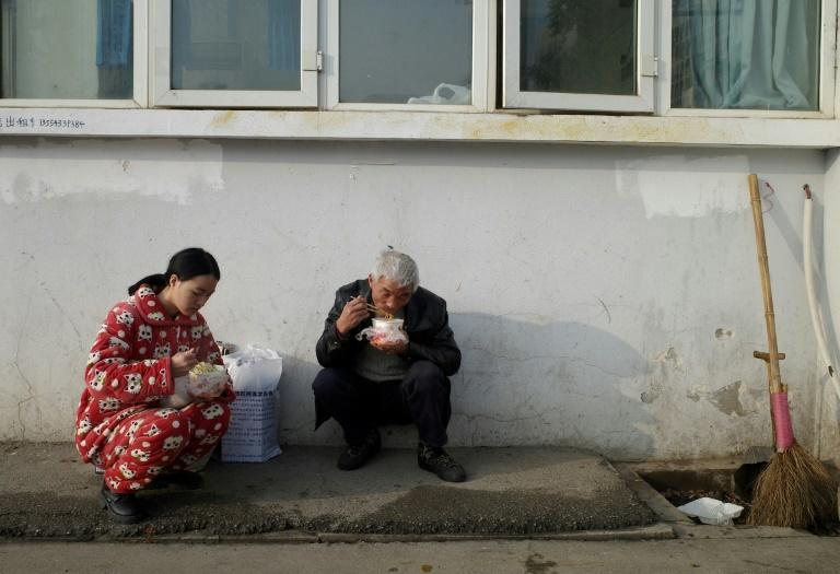 Residents of Wuhan do not seem concerned about the disease (AFP Photo/Noel Celis)
