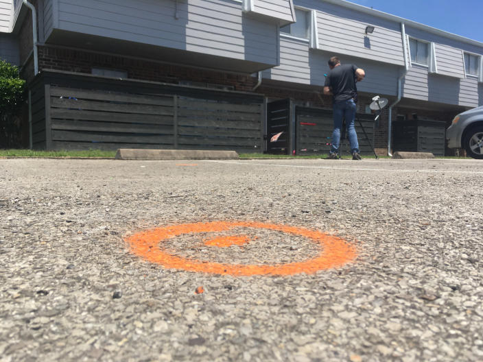 Spray paint marks the spot at the apartment complex in Baytown, Texas, where police say an officer shot and killed Pamela Turner following a struggle. (John Mone/AP)