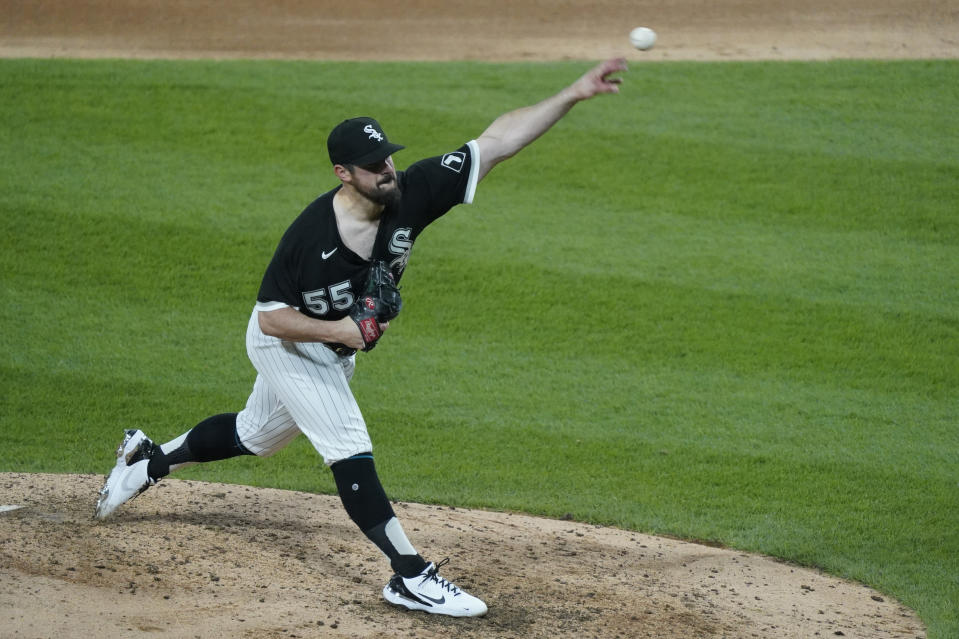 Chicago White Sox starting pitcher Carlos Rodon (55) throws against the Cleveland Indians during the fourth inning of a baseball game, Wednesday, April, 14, 2021, in Chicago. (AP Photo/David Banks)