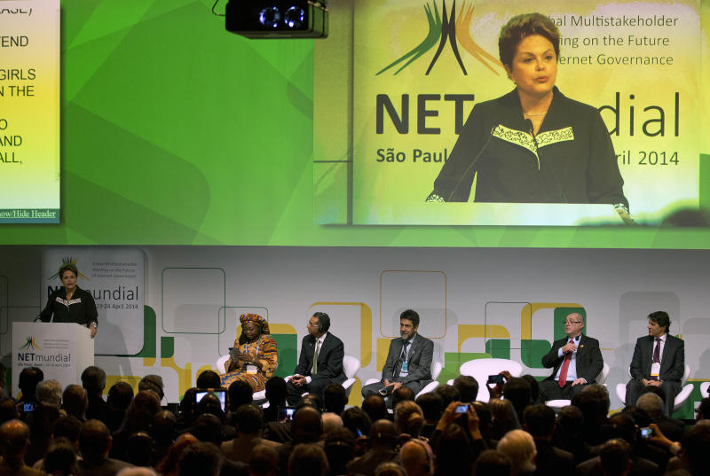 Brazil's President Dilma Rousseff addresses the opening ceremony of NETmundial, a major conference on the future of Internet governance in Sao Paulo, Brazil, Wednesday, April 23, 2014. Rousseff ratified a bill guaranteeing Internet privacy and enshrining access to the Web during the conference. The legislation, which was passed by the Senate late Tuesday, puts limits on the metadata that can be collected from Internet users in Brazil. It also makes Internet service providers not liable for content published by their users and requires them to comply with court orders to remove offensive material. (AP Photo/Andre Penner)