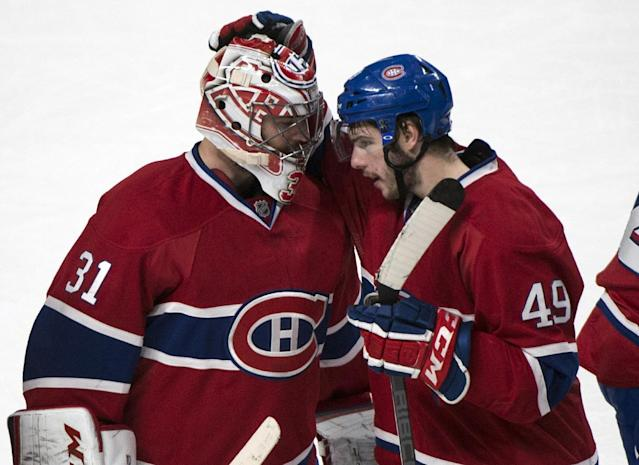 Montreal Canadiens goalie Carey Price and Michael Bournival celebrate their victory over the Boston Bruins during Game 3 of an NHL hockey Stanley Cup playoff series, Tuesday, May 6, 2014, in Montreal. The Canadiens defeated the Bruins 4-2 to take a 2-1 lead in their Eastern Conference series. (AP Photo/The Canadian Press, Paul Chiasson)