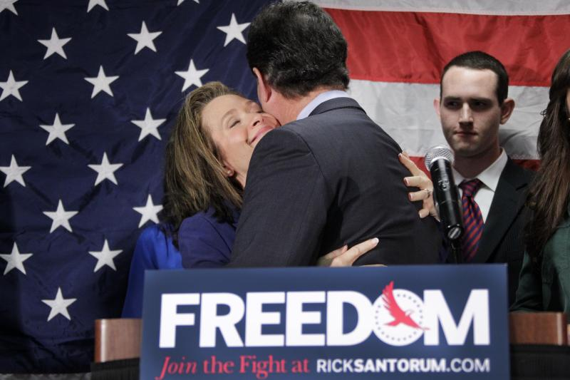 Former Pennsylvania Sen. Rick Santorum gets a hug from his wife Karen after announcing he is suspending his candidacy for the presidency, Tuesday, April 10, 2012, in Gettysburg, Pa. (AP Photo/Gene J. Puskar)