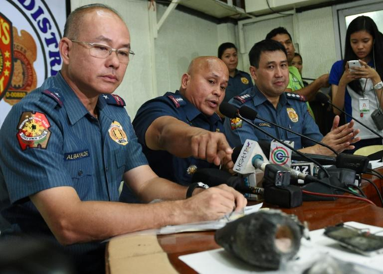 Former Philippine police chief Oscar Albayalde (L) could face charges of graft and violating the nation's anti-drug laws