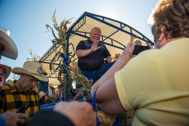 Ontario Premier Doug Ford welcomes visitors to the International Plowing Match in Verner, Ont. on Sept. 17, 2019.