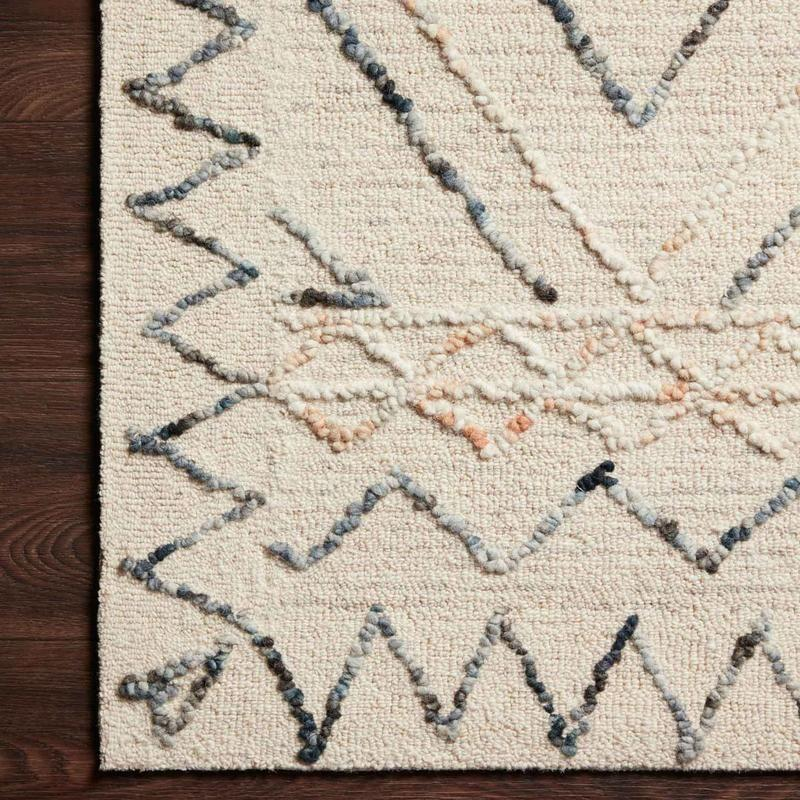 """<p><strong>Jungalow</strong></p><p>jungalow.com</p><p><strong>$99.00</strong></p><p><a href=""""https://www.jungalow.com/products/leela-oatmeal-rug-by-justina-blakeney-x-loloi-pre-order?_pos=3&_sid=06937fe5c&_ss=r"""" rel=""""nofollow noopener"""" target=""""_blank"""" data-ylk=""""slk:Shop Now"""" class=""""link rapid-noclick-resp"""">Shop Now</a></p><p>Or give your living room a revamp with this neutral rug.</p>"""