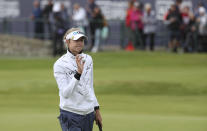 United States' Nelly Korda acknowledges the crowd after putting to complete her first round on the 18th green during Women's British Open golf championship, in Carnoustie, Scotland, Thursday, Aug. 19, 2021. (AP Photo/Scott Heppell)