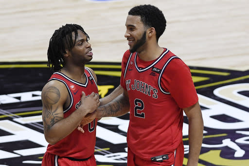 St. John's Posh Alexander, left, and St. John's Julian Champagnie celebrate their win at the end of an NCAA college basketball game against Boston College, Monday, Nov. 30, 2020, in Uncasville, Conn. (AP Photo/Jessica Hill)