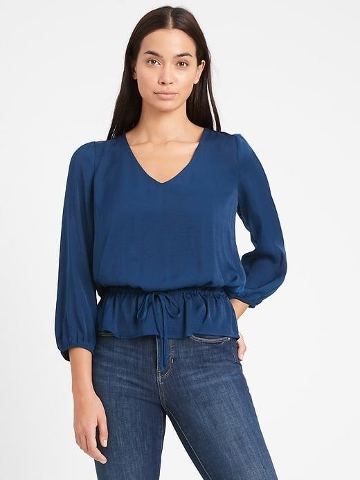 <p>And the <span>Banana Republic Satin Peplum Top</span> ($18) version looks great on different body types as well!</p>