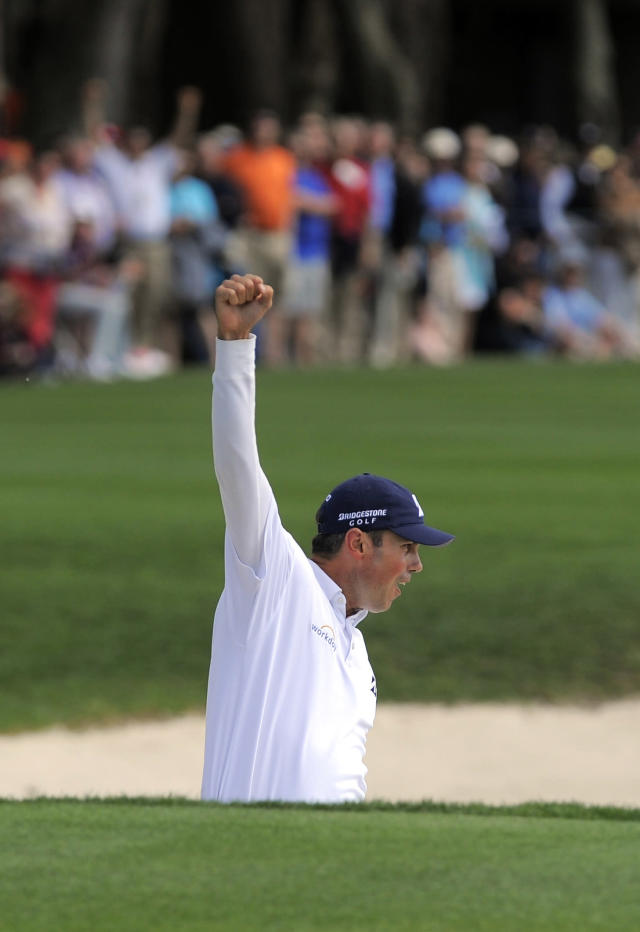 Matt Kuchar celebrates after sinking a birdie putt from the bunker on the 18th green to win the final round of the RBC Heritage golf tournament in Hilton Head Island, S.C., Sunday, April 20, 2014. Kuchar won the tournament with 11-under par. (AP Photo/Stephen B. Morton)