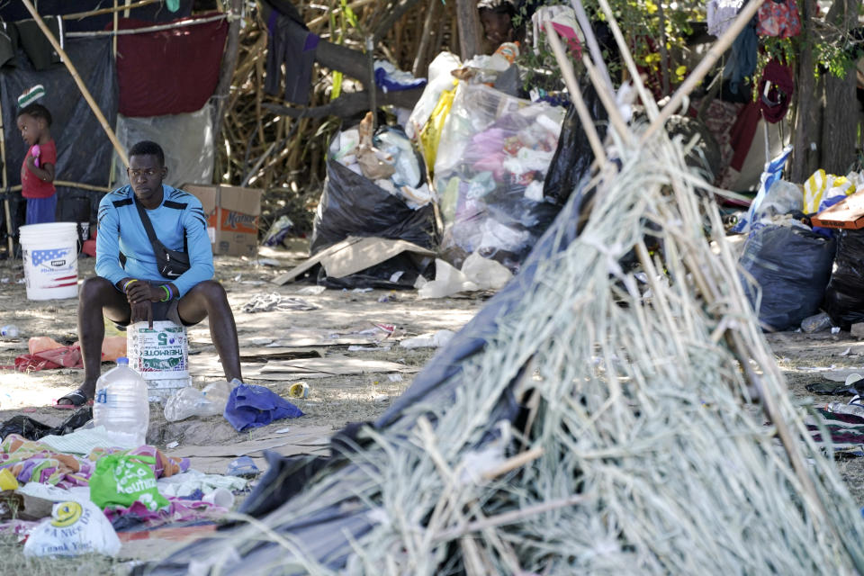 A migrant man is seen next to a hut in an encampment under the Del Rio International Bridge where migrants, many from Haiti, have been staying after crossing the Rio Grande, Thursday, Sept. 23, 2021, in Del Rio, Texas. (AP Photo/Julio Cortez)