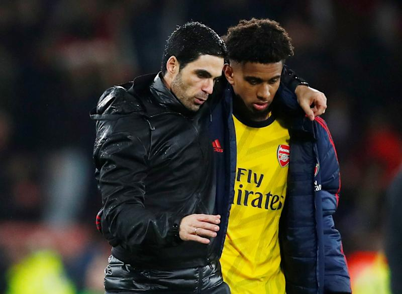 """Soccer Football - Premier League - AFC Bournemouth v Arsenal - Vitality Stadium, Bournemouth, Britain - December 26, 2019 Arsenal manager Mikel Arteta with Reiss Nelson after the match REUTERS/Eddie Keogh EDITORIAL USE ONLY. No use with unauthorized audio, video, data, fixture lists, club/league logos or """"live"""" services. Online in-match use limited to 75 images, no video emulation. No use in betting, games or single club/league/player publications. Please contact your account representative for further details."""