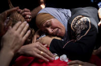 A Palestinian woman mourns over her son, Rasheed Abu Arra, who was killed in clashes with Israeli forces, during his funeral in the Village of Aqqaba near the West Bank town of Tubas, Wednesday, May 12, 2021. (AP Photo/Majdi Mohammed)