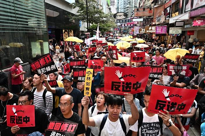 Hong Kong's government has announced plans to overhaul its extradition rules, allowing the transfer of fugitives with mainland China, Macau and Taiwan for the first time (AFP Photo/Anthony WALLACE)