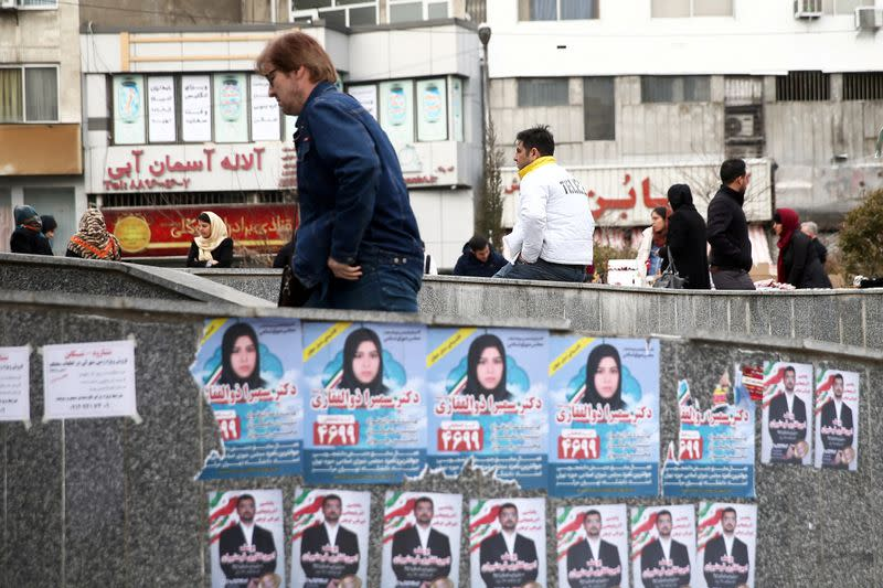 Parliamentary election campaign posters are seen in Tehran