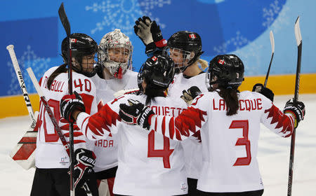 Ice Hockey - Pyeongchang 2018 Winter Olympics - Women's Semifinal Match - Canada v Olympic Athletes from Russia - Gangneung Hockey Centre, Gangneung, South Korea - February 19, 2018 - Goalie Shannon Szabados of Canada celebrates with teammates. REUTERS/Grigory Dukor