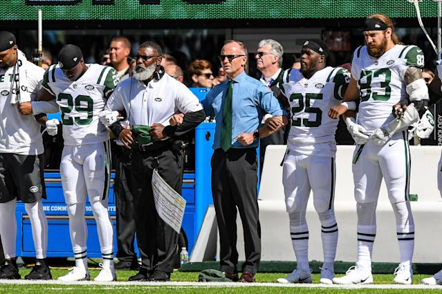 <p>New York Jets acting CEO Christopher Johnson locks arms with the entire New York Jets team during the playing of the national anthem before the game between New York Jets and the Jacksonville Jaguars at MetLife Stadium. Mandatory Credit: Dennis Schneidler-USA TODAY Sports </p>
