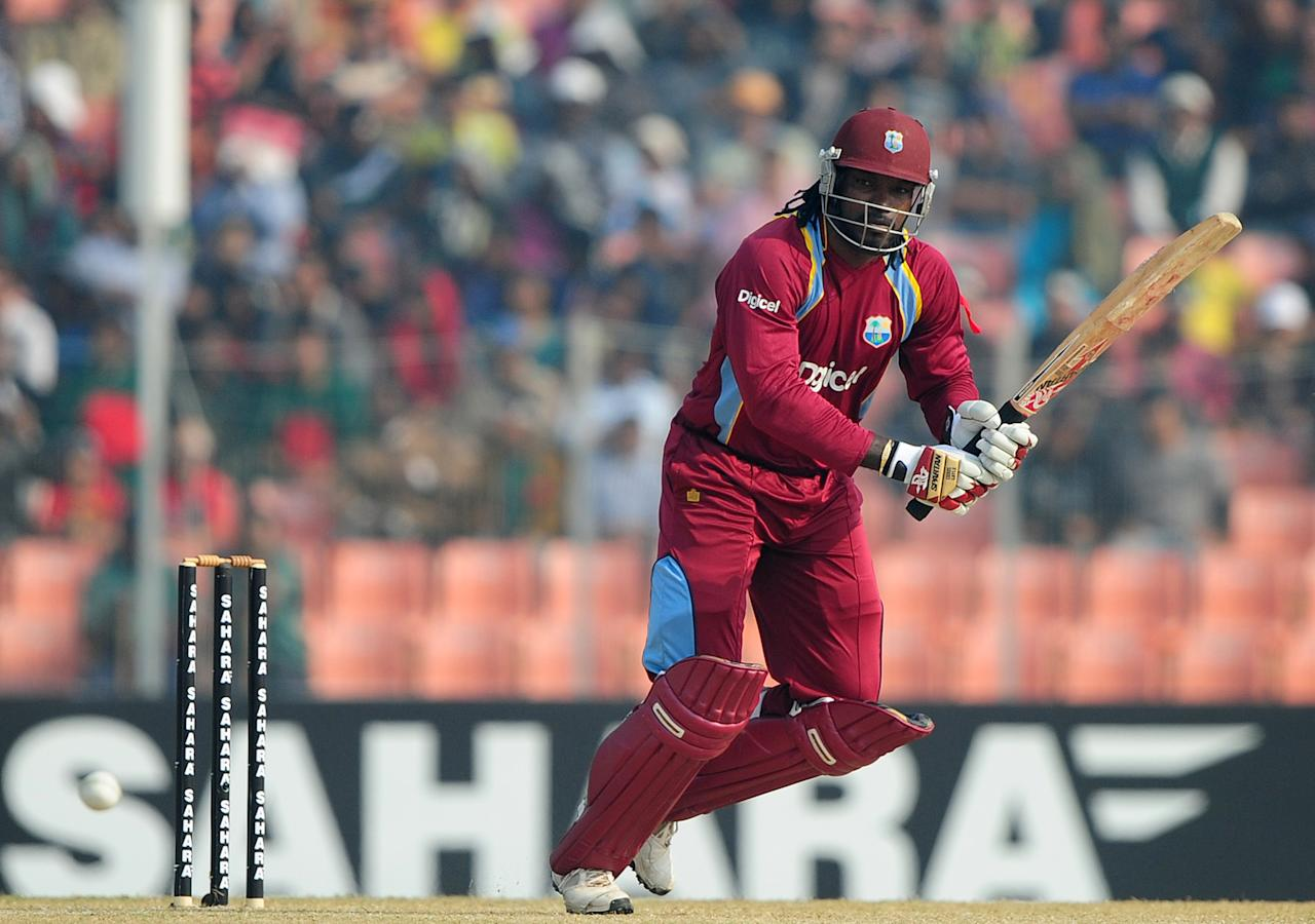 West Indies cricketer Chris Gayle plays a shot during the first one day international cricket match between Bangladesh and The West Indies at The Sheikh Abu Naser Stadium in Khulna on November 30, 2012.  AFP PHOTO/ Munir uz ZAMAN