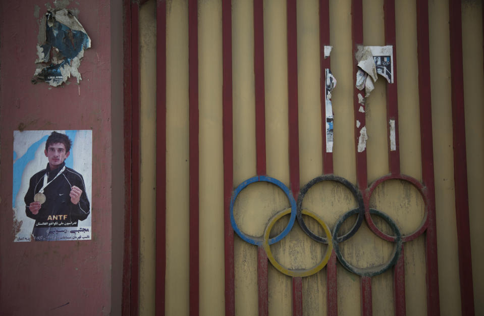 A Friday, March 15, 2013 photo shows a poster of one of Kabul's aspiring champions on the gate of the Olympic Stadium in Kabul, Afghanistan. Afghan youth use the Olympic Stadium to practice a variety of sports, including martial arts but during the time of the Taliban's regime, the hardline movement, used the stadium for public executions of convicted criminals. (AP Photo/Anja Niedringhaus)