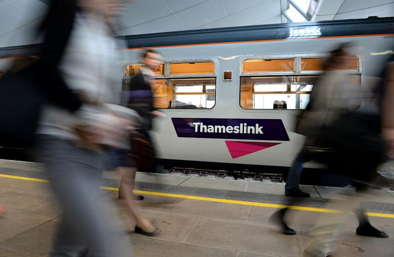 "File photo dated 15/09/14 of commuters passing a Thameslink train as Govia Thameslink Railway (GTR) which has been under fire for delays caused by strikes and staff shortages is planning the ""biggest timetable shake-up"" in a generation."