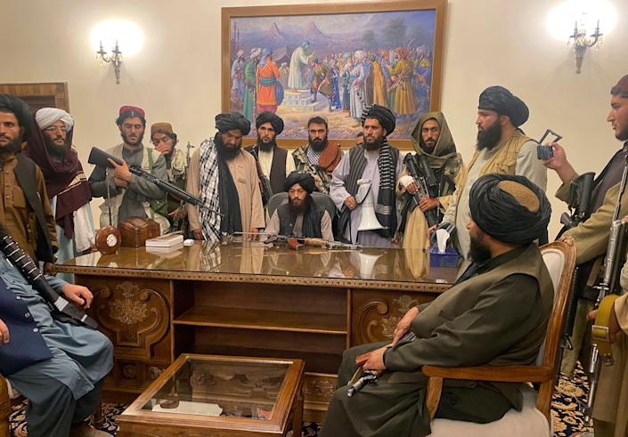 Taliban fighters take control of the presidential palace Aug. 15 in Kabul, Afghanistan, after President Ashraf Ghani fled the country.