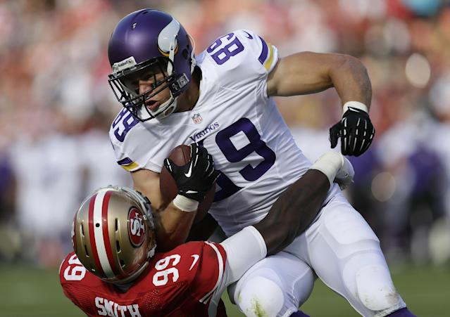Minnesota Vikings tight end John Carlson (89) is tackled by San Francisco 49ers linebacker Aldon Smith (99) during the first quarter of an NFL preseason football game in San Francisco, Sunday, Aug. 25, 2013. (AP Photo/Marcio Jose Sanchez)
